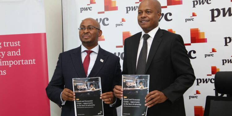 Muniu Thoithi, Partner and Advisory Services Leader, East Africa region, PwC and Peter Ngahu, Eastern Africa Region Senior Partner, PwC Kenya pose during a past event - Bizna Kenya