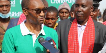 ChildFund Country Director Chege Ngugi (left) and Kajiado County Governor Joseph ole Lenku speak after the launch of the Masimba Milk Processing Plant in Emali - Bizna Kenya